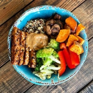 Buddha bowl with all the goodness....tempeh, quinoa, mushrooms, sweet potatoes, broccoli, onions, red peppers, and tahini dressing