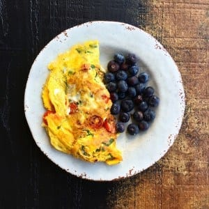 Farm-fresh omelet with a side of blueberries...all from the local farmers market
